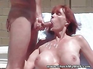 Busty MILF sucking cock and dripping cum