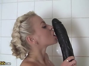 Seductive blondie is masturbating in a bathroom