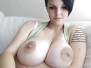 girl with short hair and huge tits plays with pussy